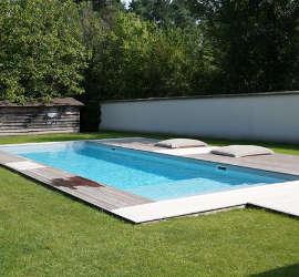Cr ations de piscines de toutes formes bourges vierzon for Piscine effet plage